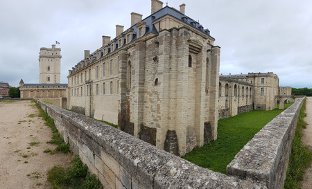 Chateau de Vincennes is ancient French castle surrounded by dried moat.