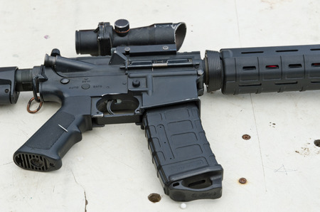Part of the assault rifle AR15 military weapon with magazine and optic scope.