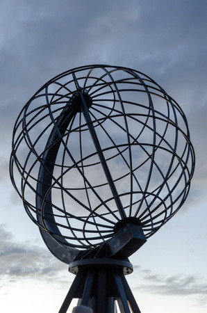 Globe monument against the sky at the viewpoint of the North Cape