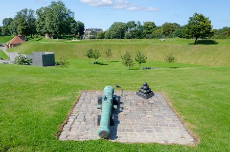 The cannon barrel and cannonballs in the ancient fortress Kastellet of the Danish capital Copenhagen