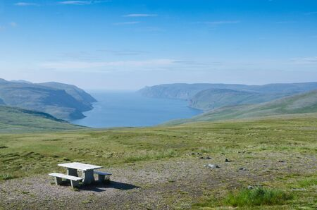 Table with benches on the hill of the island Mageroya in the extreme northern part of Norway Banque d'images
