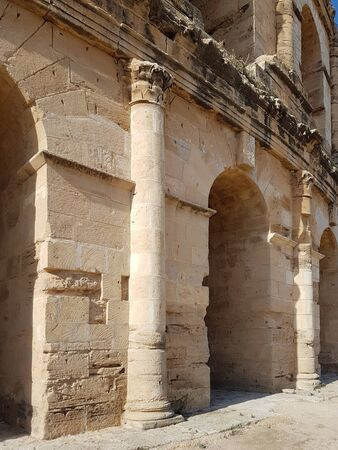 Ancient wall with columns and arcs in the ancient African colosseum of El Djem