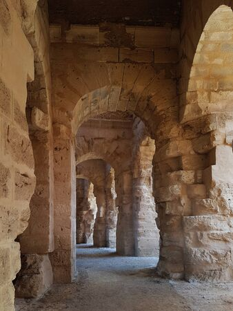 Passage or enfilade in the ancient African colosseum of El Djem in Tunisia Foto de archivo - 130723027