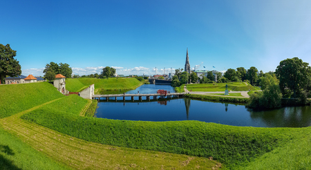 Canal, ramparts and the Kings Gate of the ancient fortress Kastellet in the Danish capital Copenhagen