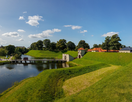 Channel, ramparts and the Kings Gate of the ancient fortress Kastellet in the Danish capital Copenhagen