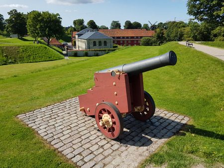 Decorative cannon of the ancient fortress Kastellet in the Danish capital Copenhagen Editorial