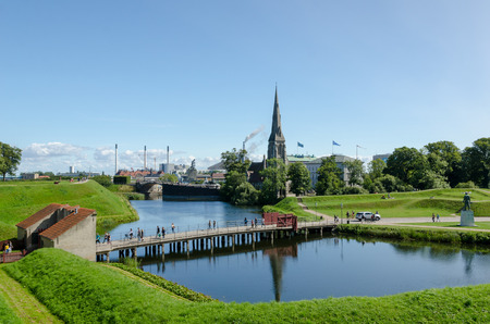Canal and bridge of the Kings Gate to the ancient fortress Kastellet in the Danish capital Copenhagen Editorial