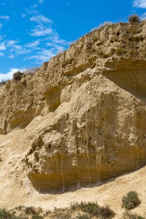 Stratified wall of the gorge in the Spanish badlands Bardenas Reales