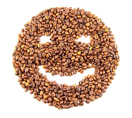 Roasted coffee beans placed in the shape of a smiling face isolated on white background Stock Photo