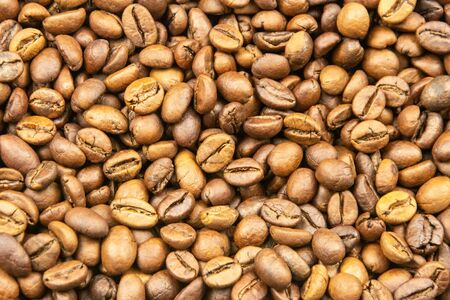 Roasted coffee beans close-up for background