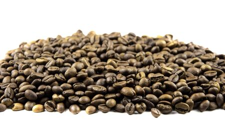 roasted coffee beans isolated on white background with bokeh effect Фото со стока