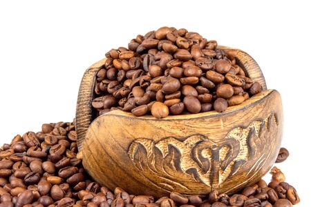 Roasted coffee beans spilling from a wooden box isolated on white background