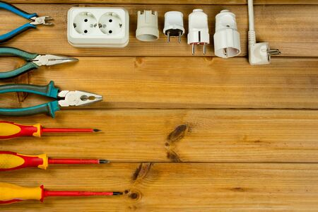 Electrician tool on wooden background with copy space. Top view. Flat lay