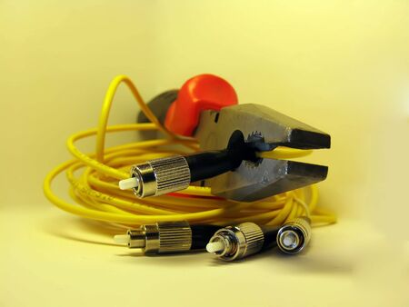 Two optical patch cords and pliers photo