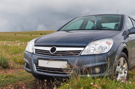 Car on the grass after the rain in Crimeam mountains photo