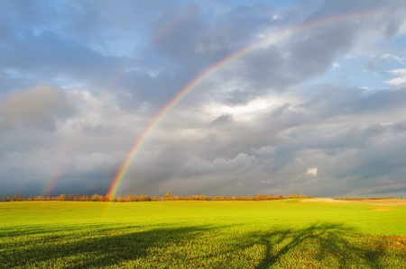 rainbow scene: Double rainbow over the field with green grass, Crimea, Ukraine