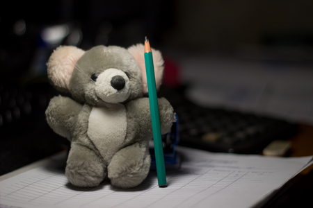 plaything: soft toys and stationery, grey toy with a pencil,very cute