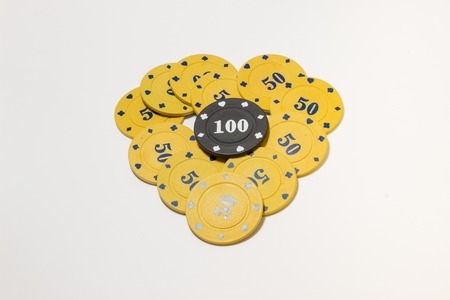 well laid: heart symbol of love is laid out poker chips, it means love for this game, to win, as well as income