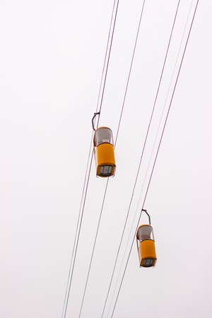chairlift on sky background is a very good form of transport you can admire the beautiful views from the heights Stock Photo