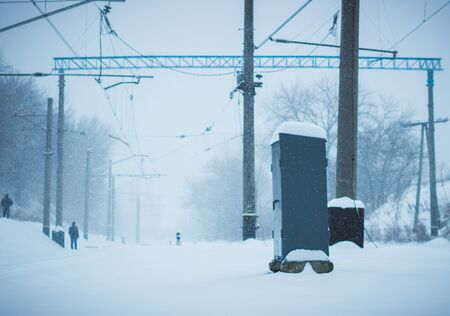 cold winter view of the railroad tracks, a very beautiful snow falls