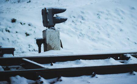 cold winter view of the railroad tracks, a very beautiful snow falls Banco de Imagens - 67264870