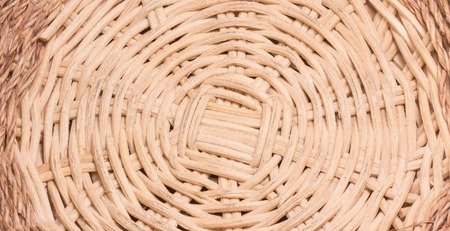 Background braided basket, very pretty, wooden bars texture