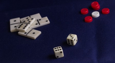 items for table games, against the background of the tissue, many people are very fond of table games, they develop logic and reasoning, and just a pleasure to spend time Stock Photo