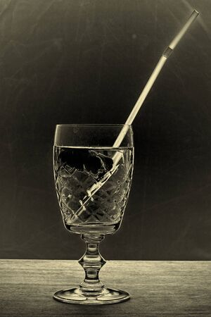 glass for drinks on a nice colored background rayed on a beautiful vintage glass patterns
