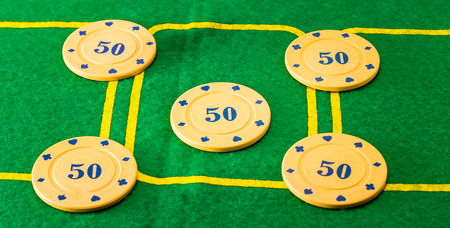 constitute: Five chips on the poker field, such chips constitute the prize money to the player who wins the game