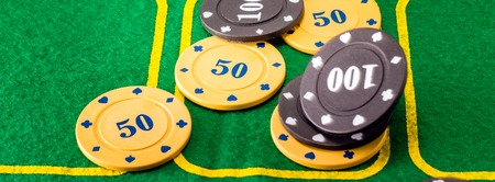 differs: For winning the most popular card game called poker, such plastic chips are given, but the price of these chips differs Stock Photo