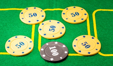 Background of six plastic chips for poker, one is different one it is more expensive and meaningful than the rest