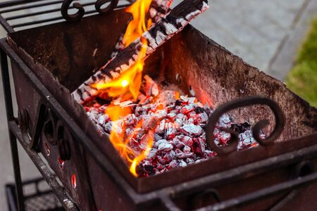 Red-hot charcoal in a barbecue preparation for frying meat