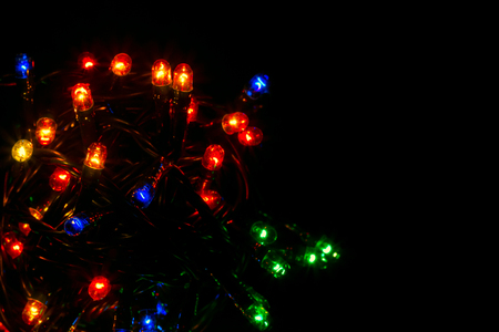 Beautiful multicolored garlands of red green blue on a dark background festive lighting