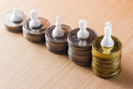 Chess pieces symbolizing different stages of a career on a wooden background