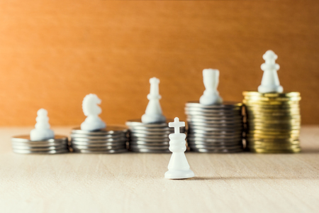 King against the backdrop of a career ladder with the example of chess pieces