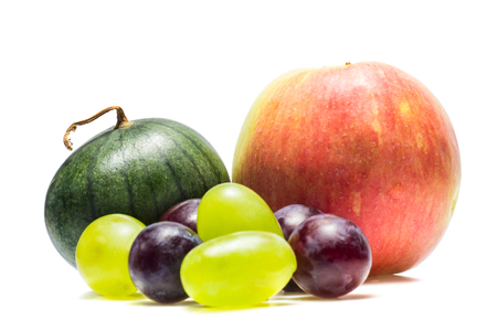 apple watermelon and grapes of different varieties on a white background delicious and healthy fruits