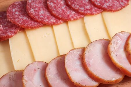 appetizing pieces of smoked and homemade chicken sausage and cheese