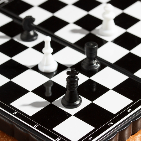 chess king heads his army on the playing field