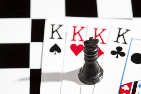 black chess king in the background of playing cards objects for popular board games 版權商用圖片
