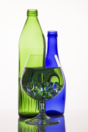 beautiful green patterns in a glass with liquid and decorative balls bright and exciting