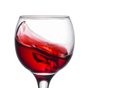 small wave of red wine in a glass delicious splash of a delicious alcoholic drink on a white background