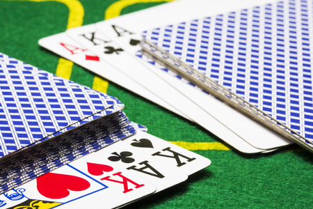 poker background two decks of cards and outstanding combinations on a green canvas concept of board games