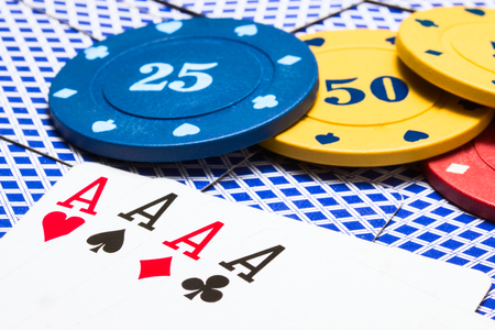 combination of four aces and bright multi colored poker chips concept of gambling Stock Photo