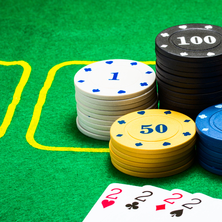 round plastic poker chips and a combination of playing cards concept of gambling and casino