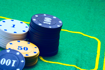 columns of poker chips on the playing canvas concept of casino and gambling