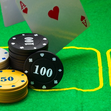 playing field for poker round chips and falling cards concept of casino and gambling