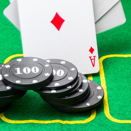 arch of poker chips against the background of a falling ace of diamonds on a bright green canvas concept of gambling and casino