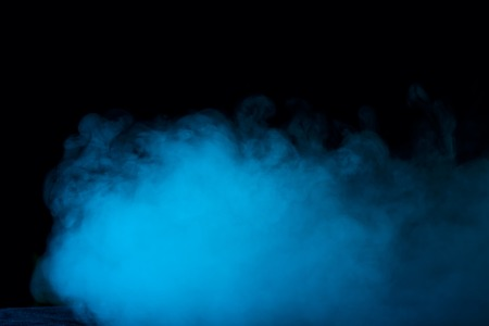 dense and mysterious blue vapor on a dark background an exciting atmosphere