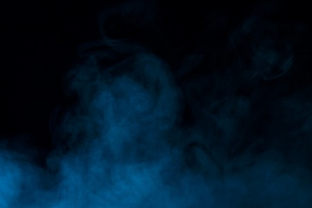 mystical blue steam on a dark background concept of smoking and halloween Imagens