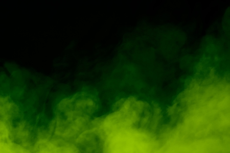 bright green steam on a dark background concept of smoking and halloween exciting atmosphere Imagens